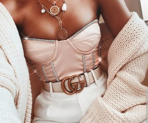 belt, bustier, and cardigan image