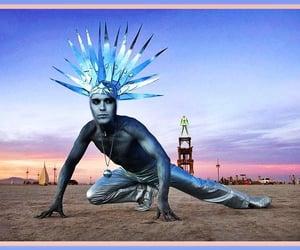 Burning Man, tribal, and illuminati image