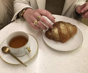 coffee, croissant, and gold image