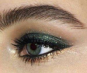 gold, eyeliner, and glam image