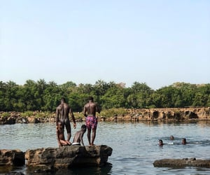 africa, river, and swimming image