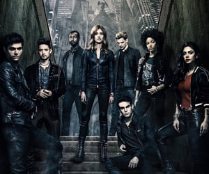 clary fray, magnus bane, and dominic sherwood image