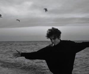 black and white, boy, and ocean image