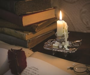 books, candle, and Letter image