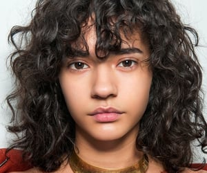 bangs, brown hair, and curly image