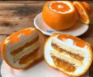 cream, dessert, and oranges image