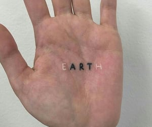 tattoo, earth, and hand image