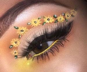 cateye, glow, and sunflowers image