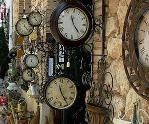 clocks, flowers, and time image