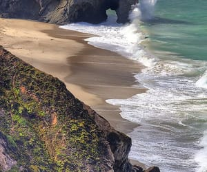 rocks, shore, and sea image
