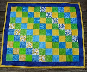flower print, bluebutterfly, and child doll quilt image