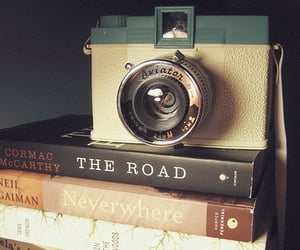 book, camera, and the road image