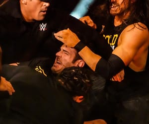 wwe, roderick strong, and adam cole image
