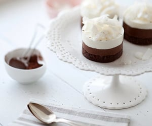 chocolate mousse, coconut mousse, and gluten free mousse cake image