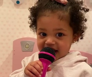 stormi webster, curly hair, and mic image