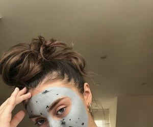 face mask and messy bun image