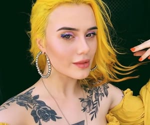 colored hair, piercing, and tattoo image