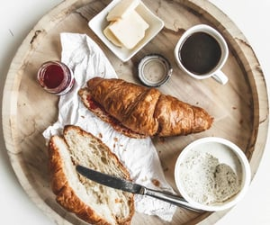 bed, breakfast, and croissants image