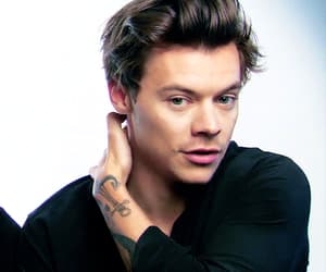 black shirt, hairstyle, and one direction image