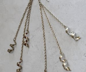 chain, shoulder dusters, and chain earrings image
