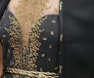 black dress, gold dress, and haute couture image