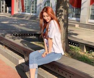 yuna, chaeryeong, and hwang yeji image