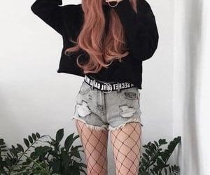 belt, black sweater, and denim shorts image
