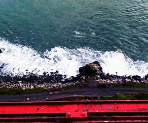 bridge, road, and ocean image