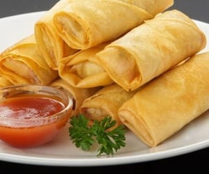 food and spring rolls image
