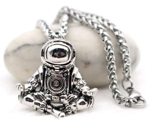 astronaut, stainless, and meditating image