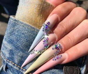 claws, matte nails, and nail art image