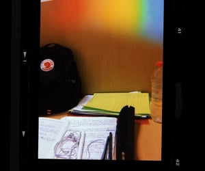 backpack, headphones, and papers image