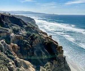 beach, blue skies, and cliffs image