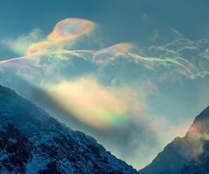 cloud, sun, and mountains image