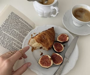 books, coffee, and croissant image