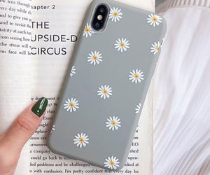 flowers, phone, and book image