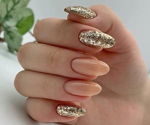 glitter, gold, and stiletto nails image