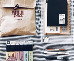 collection, notebook, and pencil image