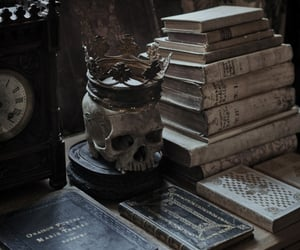 book, crown, and skull image