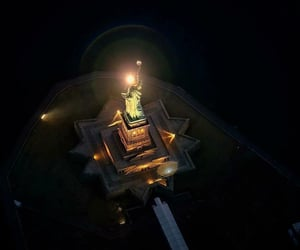 aerial photography, city, and statue of liberty image