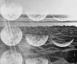 black and white and moons image