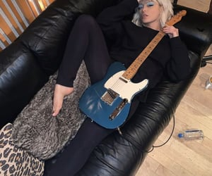 guitar and bebe rexha image