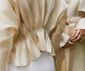 pleats and satin blouse image