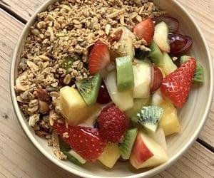 ananas, apple, and bowl image