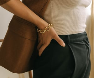 bracelet, gold chain, and brie leon jewelry image