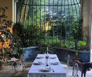 big window, table, and green image