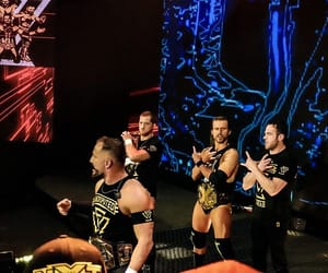 wwe, adam cole, and undisputed era image