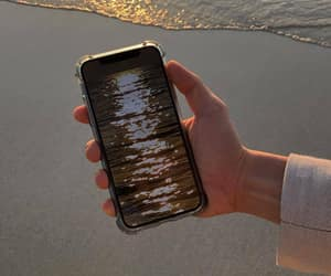 beach, hand, and iphone image
