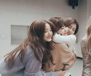 miyawaki sakura, jang wonyoung, and kang hyewon image