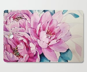 pink petals, water bottle, and cutting boards image